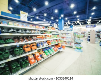 Blurred of kids toy store background with bokhe. shelves with cars and aisle of kids toy shop interior, copy space