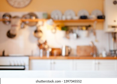 Blurred kitchen background. Cozy home scene and atmosphere hygge. Warm light.