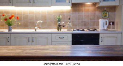 blurred kitchen interior and desk space