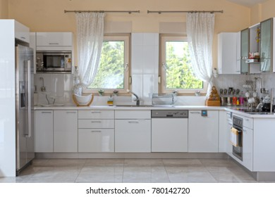 Blurred Kitchen Interior in Light Tones with White Furniture