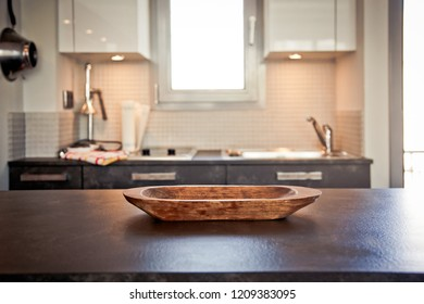 blurred kitchen interior with wooden plate and desk space