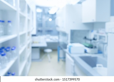 BLurred laboratory interior, scientific background with copy-space. Modern research facility room out of focus. This blurred image toned in blue