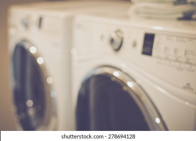 Blurred Laundry Room with Washer and Dryer with Retro Instagram Style Filter
