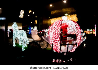 Blurred LED light horses with a carriage decoration composition
