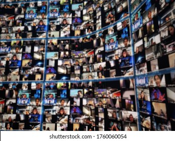 Blurred LED screen of many people faces join big online live event. Work at home ,video conference ,social distancing due to covid-19. New normal event production. Online meeting or seminar.