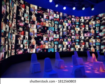 Blurred LED screen of many people faces join big online event or live conference.Work at home.Video online conference.Social distancing in state quarantine.New normal event production.Online meeting