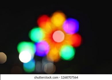 Blurred of light beam in Thai temple fair.
