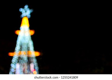 Blurred light bokeh of christmas tree , ca n used for Gift Card of Happy New Year and Christmas. copy space for text at right.