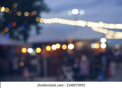 Blurred light night, defocus, bokeh, night market concept,blur lens,beautiful circle glitter merry Christmas and happy new year card celebrating lamp dark sky festival dusk blurry flare reflect