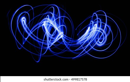Blurred Light painting, Abstract of lighting equipment. Abstract blue neon painting. Bokeh glitter round shapes . Abstract lights at motion exposure time