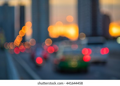 Blurred light of street with sunset bokeh background