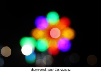 Blurred of light in Thai temple fair.