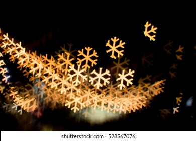 blurred lights bokeh background of snow fkakes