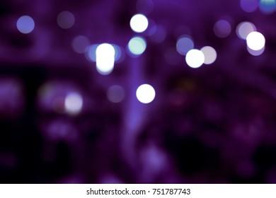 BLURRED LIGHTS ON DARK PURPLE BACKGROUND