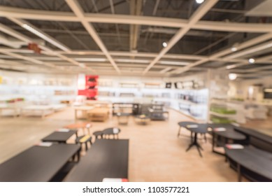 Blurred living room supplies at huge furniture store in America. Variety sofa, chairs, recliner, coffee table, sofa table, ottoman display at interior showroom. Home furnishings living room concept