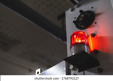 blurred low key Illuminated factory industry red alert emergency light with copy space for background. Attention concept, tragedy, emergency, safety and insurance