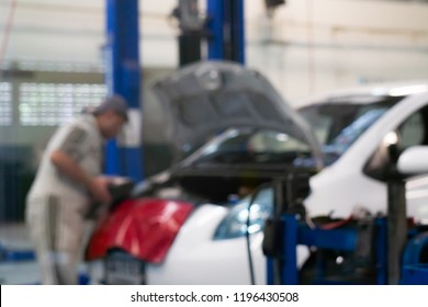 Blurred : Maintenance technicians are checking the engine of the car in the center of service standards.
