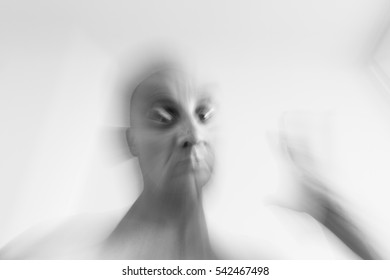 Blurred man suffering from mental disorder and schizophrenia