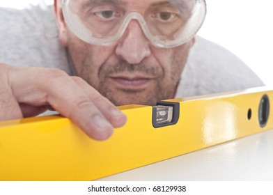 Blurred man working with a yellow bubble level isolated over white