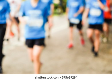 Blurred marathonrunning race people competing in park, Fittness and healthy active lifestyle