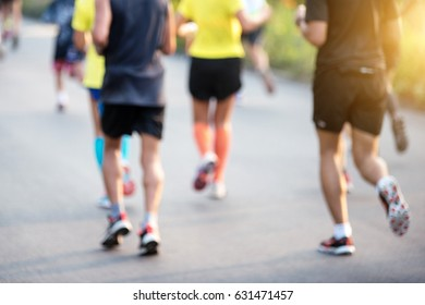 blurred mass of marathon runners