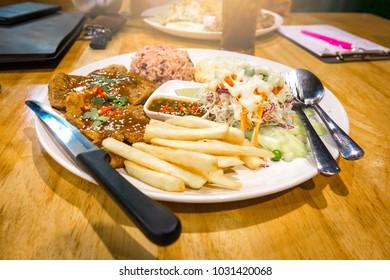 Blurred meal dinner concept. It meat on  food desk in  restaurant