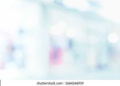BLURRED MEDICAL BACKGROUND, MODERN HOSPITAL HALL, LIGHT BLUE INTERIOR
