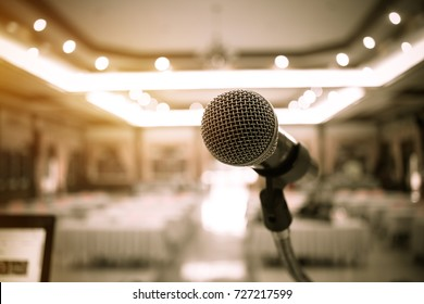 Blurred of microphones in seminar room, talking speak in conference hall light with microphone and keynote. Speech is vocalized form of communication humans.
