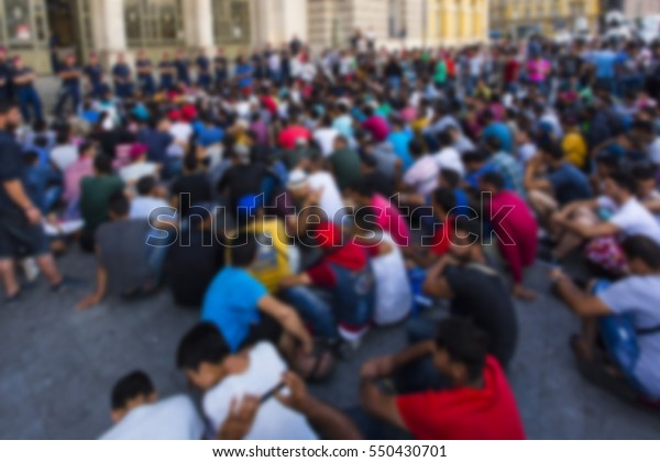 blurred migrant people in the railway station