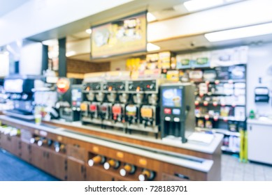 Blurred modern convenience store gas station in Arkansas, USA. Variety items on display such as impulse snack, energy drink, coffee, hot food, tobacco, cigarette, clothes, lottery ticket. Vintage tone