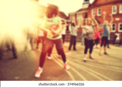 Blurred Modern dancers dancing on the street. Urban lifestyle. Hip-hop generation.