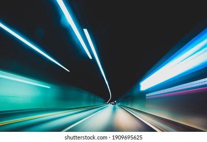 blurred modern underground tunnel in long exposure showing speed