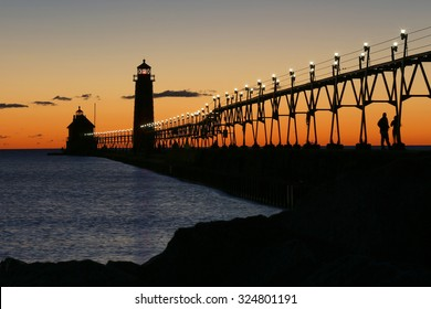 Blurred motion affect with water during sunset at the Grand Haven South Pierhead Lighthouse in Grand Haven State Park in Grand Haven, Michigan
