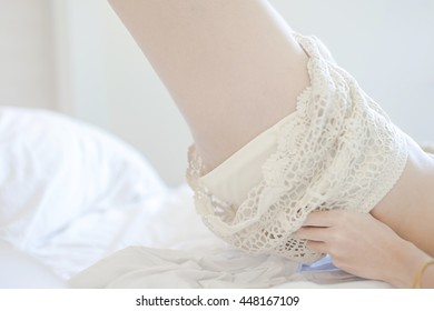 blurred motion close-up Young sexy girl remove her panties on bed, Toned picture
