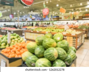 Blurred motion customer shopping for fresh produces, fruits, vegetables at Asian supermarket in Texas, USA.