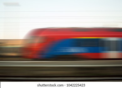 Blurred motion of express train vehicle on railway, high speed concept.