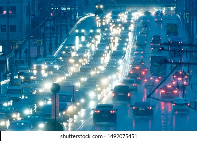 Blurred motion on the highway in the rain nigh. Big traffic in the city. The summer urban highway filled cars. To be late. Long exposure. For greeting card design, postcard template, guide, poster.