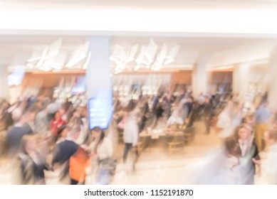 Blurred motion people have happy hour, casual business meeting at the lobby of luxury hotel in San Francisco, California, USA. Blurry abstract background industry networking event