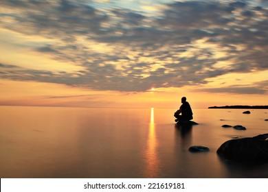blurred motion people sunset lake