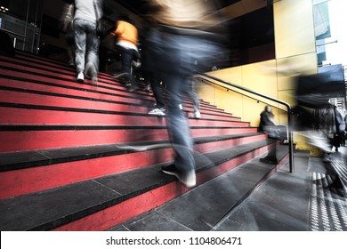 Blurred motion of people walking up the stairs into a building in melbourne, Australia