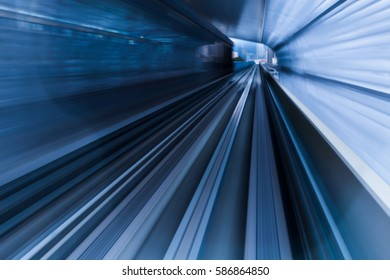 Blurred motion subway moving into tunnel, abstract background