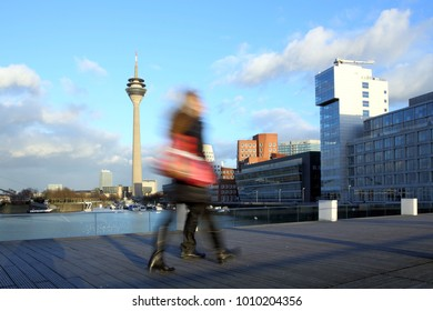 Blurred motion women with shopping bag in Dusseldorf Media Harbor district