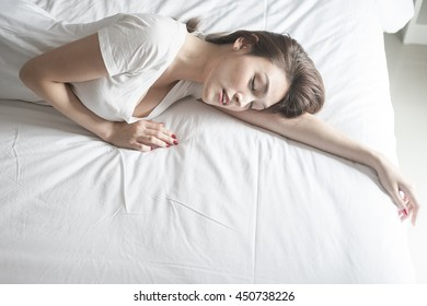 blurred motion Young sexy woman on bed, Toned picture
