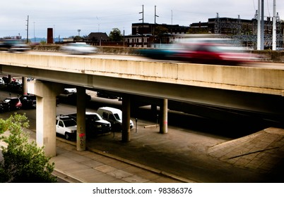 Blurred moving automobiles on a busy interstate highway
