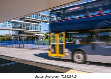 Blurred moving bus at park and ride transport station busway on North Shore, New Zealand, NZ