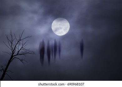 Blurred mysterious people against a foggy background at night.