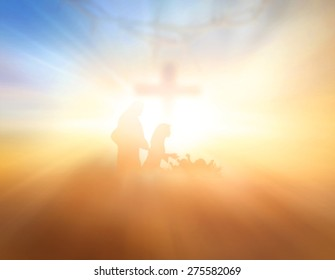 Blurred Nativity Christmas scene and cross with crown of thorn on sunrise background