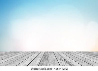 blurred natural blue sky gradient glow backdrop wall with old white wood texture panel color background texture table top for advertise,show,promote products on display