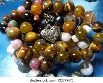Blurred natural semiprecious stone bracelet bokeh used for background
