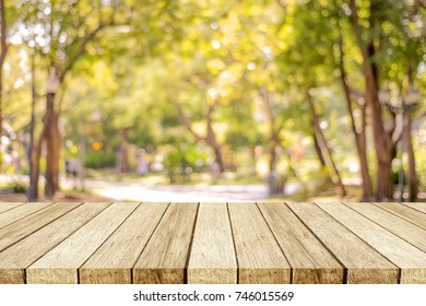Blurred nature background, Empty wooden table over blur nature park outdoor background, blank tabletop design for product display montage template